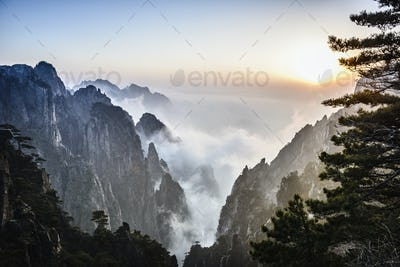 54359,Fog rolling over rocky mountains, Huangshan, Anhui, China