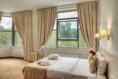 54089,Bed and curtains in hotel room