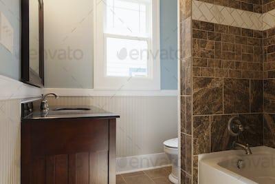 53990,Sink, bathtub and toilet in bathroom