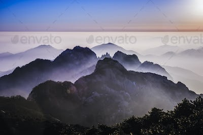 54364,Fog rolling over rocky mountains, Huangshan, Anhui, China