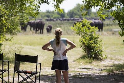12 year old girl looking at elephants, Moremi Reserve, Botswana