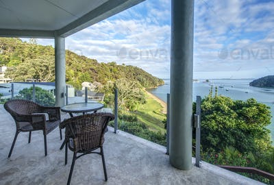 53831,Table and chairs on balcony overlooking Bay of Islands, Paihia, New Zealand