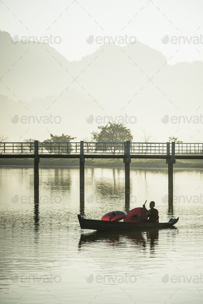 55011,Mountains and bridge reflected in still lake, Hpa an, Kayin, Myanmar