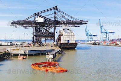 55284,Cranes over cargo ship in harbor