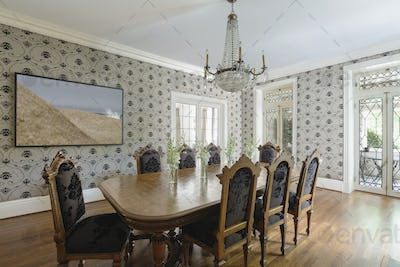 54447,Table and chairs in ornate dining room