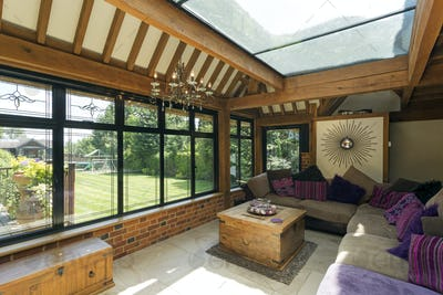 54160,Cushioned benches in sunny conservatory