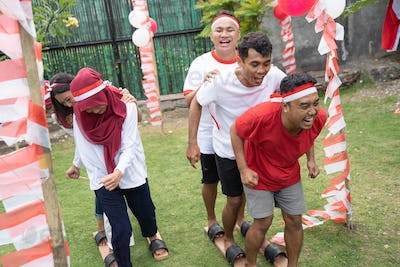 participants were happy at traditional bakiak race in celebration