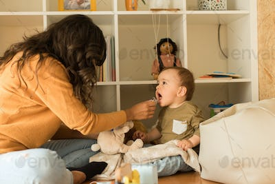 Mother playing with toddler at home
