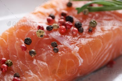 Close up View of Raw Fresh Salmon With Spicy Pepper