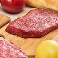 Fresh Raw Meat on Wooden Cutting Board Near Lemon6 Apples And Baguette