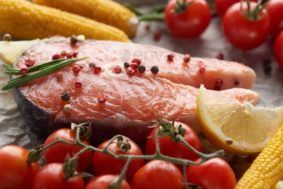 Raw Fresh Salmon With Spices, Lemon And Tomatoes