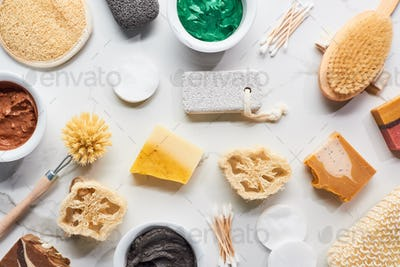 Top View of Bath Sponges, Body Brushes, Hygiene Supplies, Soap And Clay Mask on Marble Surface