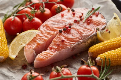 Raw Fresh Salmon With Spices, Lemon, Corn And Tomatoes