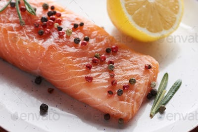 Close up View of Raw Fresh Salmon With Pepper, Lemon And Rosemary