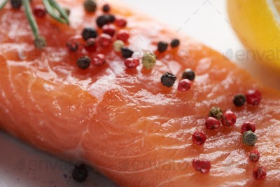 Close up View of Uncooked Fresh Salmon With Spicy Pepper