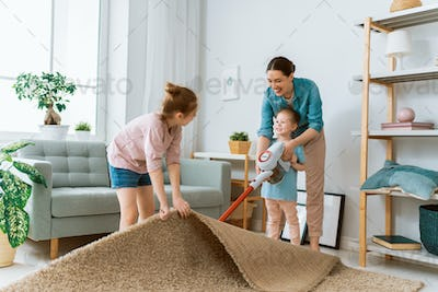 family cleaning the room