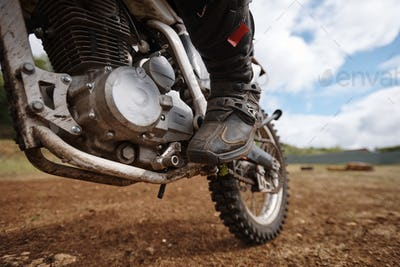 Motorcyclists foot on pedal