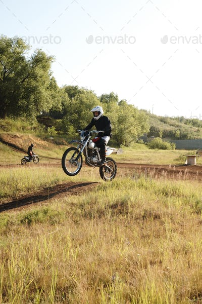 Motorcyclist making step-up