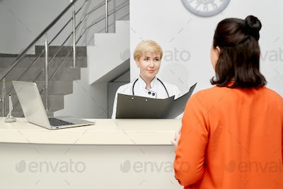 Doctor listening to patient on reception
