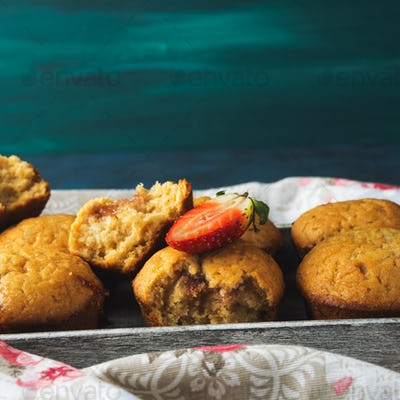 Peanut butter muffins with strawberry jam