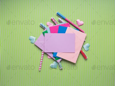 Colorful pens and envelopes with blank card