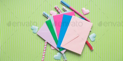 Colorful pens and envelopes. Pastel flat lay