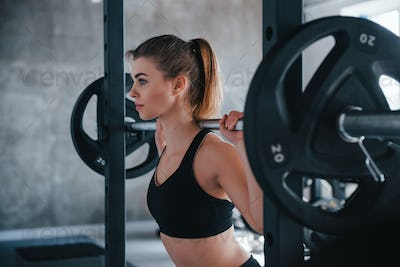 Confident look. Photo of gorgeous blonde woman in the gym at her weekend time