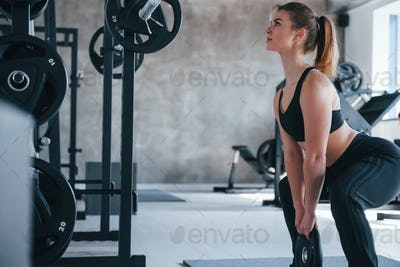 Just a few moments. Photo of gorgeous blonde woman in the gym at her weekend time