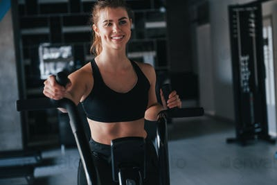Losing weight. Photo of gorgeous blonde woman in the gym at her weekend time