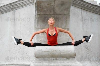 Beautiful female modern dancer performing outdoors