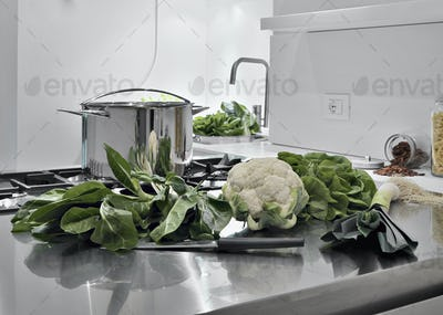 Some Vegetables on the Worktop in Kitchen