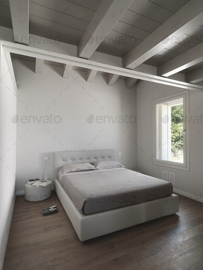 Interiors of a Modern Bedroom With Wood Floor