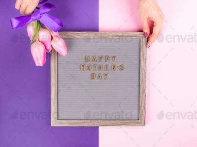 Mother's day greetings on letter board and tulips