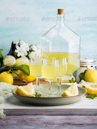 Home made limoncello in stemmed glasses