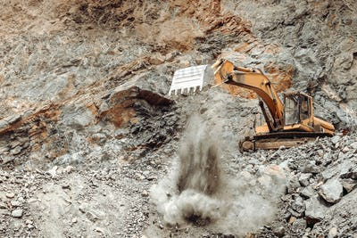 heavy duty machinery activity. Excavator working and unloading earth soil and rocks