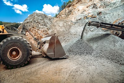 Mining industry. Industrial vehicles on construction site