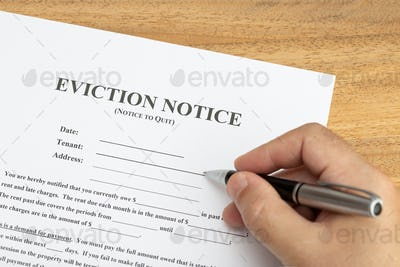 Hand ready to fill a Eviction Notice Document