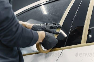 Preparing a car before spray painting