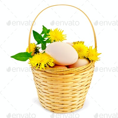 Eggs in a basket with dandelions