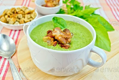 Soup puree with bacon and croutons on fabric