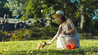 Young girl feeding a squirrel in Central Park