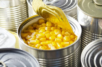 Canned sweet corn in just opened tin can. Non-perishable food