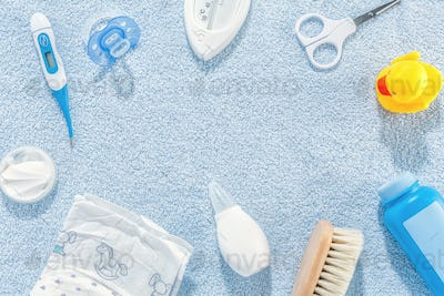 Baby care accessories on blue background
