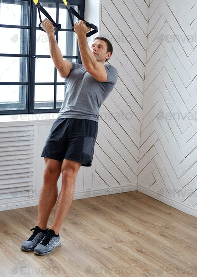 Middle age man doing workouts.