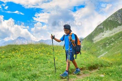 Child during alpine trekking