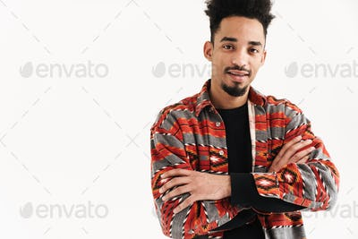 Positive young man posing isolated