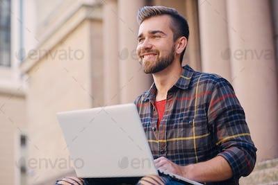 A man using a laptop.