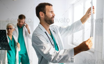 Group of doctors checking x-rays in a hospital