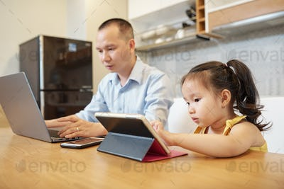 Father and daughter working on gadgets