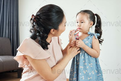 Mom and daughter doing make-up